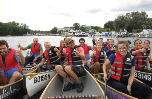 Company outing by canoe
